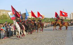 Horsemen of the Kremlin Riding School with the flags of the hero-cities Royalty Free Stock Image