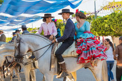 Horsemen. MALAGA, SPAIN - AUGUST 21, 2014: Horsemen taking a rest at Malaga August Fair Royalty Free Stock Photos