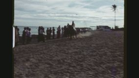 Horsemen Riding By The Sea. TUNISIA, GABES REGION, WINTER 1973. Three Shot Sequence With Pans Of Two Horsemen Riding Fast By The Sea In Preparation For The stock footage