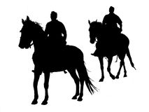 Horsemen Silhouette Stock Photo