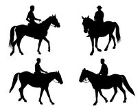 Horsemen Silhouettes Stock Photos