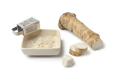 Horseradish and grater Royalty Free Stock Photography