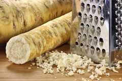 Horseradish. With grater on wooden background Stock Photo