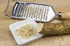 Horseradish and a rasp Stock Photo