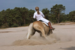 Horseriding in the dunes Stock Photos