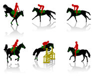 Horses-3. Silhouettes of equestrians on horses during competitions Royalty Free Stock Photo