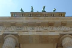 Horses at the Brandenburg Gate in Berlin. May 2011, travel to Berlin. Brandenburg Gate. Green heads of horses are looking down on you against the blue sky royalty free stock photos