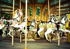 Horses on a carnival Merry Go Round Stock Photo