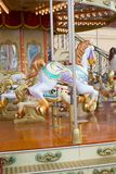 Horses on a carnival Merry Go Round. Stock Photography