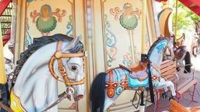 Horses in Carousel Merry Go Round stock video