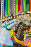 Horses carousel Stock Images