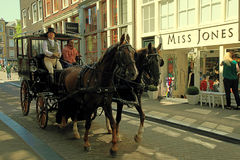 The horses carriage in old street of Amsterdam, The Netherlands Stock Images