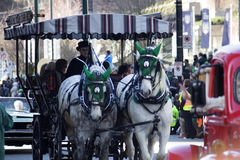Horses and carriage at st.patrick's day parade Stock Photos