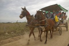 Horses and carriage taking townspeople home from El Rincon, Cuba Stock Photos