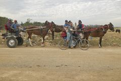Horses and carriage taking townspeople home from El Rincon, Cuba Royalty Free Stock Images