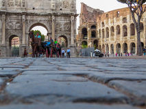 Horses carriages in front of the Colosseum Stock Photography