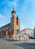 Horses and carts on the market. POLAND, CRACOW - May 7, 2015: Horses and carts on the market squar in Cracow Royalty Free Stock Photography