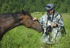 Horses graze Stock Images