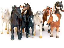 Horses group. Close up of the group of plastic toys - horses isolated on white background Royalty Free Stock Image