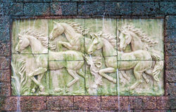 Horses in low relief statue Royalty Free Stock Photos