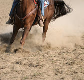 Horses and men in the dust Royalty Free Stock Image