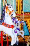 Horses in merry go round fairground. Attraction Royalty Free Stock Photos