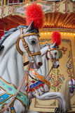 Horses in a Merry Go Round Stock Images