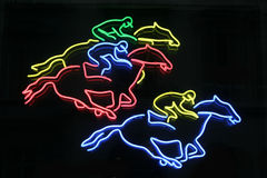 Horses neon. A neon sign for horse racing in vienna, austria Royalty Free Stock Photos