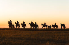 Horses Riders Silhouetted Dawn Royalty Free Stock Photos