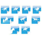 Horses silhouettes icons. On blue signs Stock Image