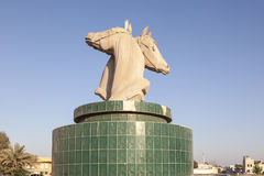 Horses statue in Umm Al Quwain. Horses statue in a roundabout in Umm Al Quwain. United Arab Emirates, Middle East stock images