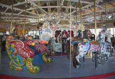 Horses on a traditional fairground B&B carousel at historic Coney Island Boardwalk in Brooklyn. BROOKLYN, NEW YORK - MAY 17, 2014: Horses on a traditional Stock Image