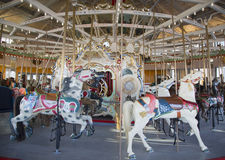 Horses on a traditional fairground B&B carousel at historic Coney Island Boardwalk in Brooklyn. BROOKLYN, NEW YORK - MAY 17, 2014: Horses on a traditional Stock Images