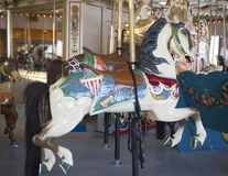Horses on a traditional fairground B&B carousel at historic Coney Island Boardwalk in Brooklyn. BROOKLYN, NEW YORK - MAY 17, 2014: Horses on a traditional Royalty Free Stock Photography