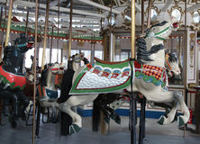 Horses on a traditional fairground B&B carousel at historic Coney Island Boardwalk Stock Image