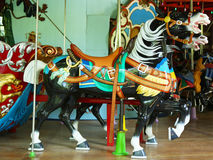 Horses on a traditional fairground carousel Royalty Free Stock Images