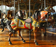 Horses on a traditional fairground carousel Stock Image