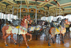 Horses on a traditional fairground Jane's carousel in Brooklyn. BROOKLYN - APRIL 30:Horses on a traditional fairground Jane's carousel in Brooklyn on April 30 Royalty Free Stock Photo