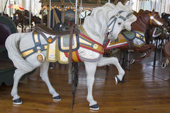 Horses on a traditional fairground Jane's carousel in Brooklyn. BROOKLYN - April 24:Horses on a traditional fairground Jane's carousel in Brooklyn on April 24 Stock Image