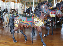 Horses on a traditional fairground Jane's carousel in Brooklyn. BROOKLYN - April 24:Horses on a traditional fairground Jane's carousel in Brooklyn on April 24 Royalty Free Stock Images