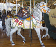 Horses on a traditional fairground Jane's carousel in Brooklyn. BROOKLYN, NEW YORK - APRIL 24, 2014: Horses on a traditional fairground Jane's carousel in Stock Photo