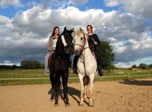 Horses and women Stock Photos