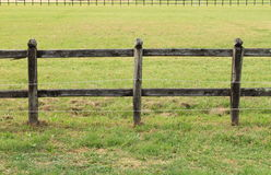 Horses wooden fence. Wooden fence on a green meadow used for horse containment royalty free stock photography