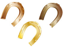 Horseshoe. Three horseshoes from precious metals on a white background Royalty Free Stock Images