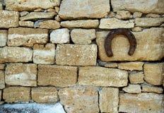Horseshoe on. Ancient rocky wall Stock Photos