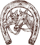 Horseshoe. Vector image of a horseshoe with a horses' heads - a symbol of good luck and happiness Stock Image