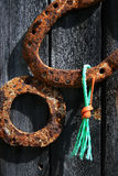 Horseshoe. Rusty horsehoe on the wooden fence Royalty Free Stock Photos