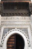 Horseshoe Arch decorated with Arabic Mosaic and Moroccan Arabesque Carvings at the Medieval Medina of Fes al Bali Royalty Free Stock Photography