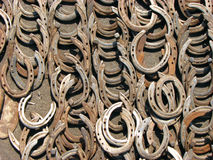 Horseshoe Background. A background of old rusted horseshoes. These are also traditionally used as goodluck charms for centuries in many cultures Stock Photo