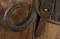 Horseshoe and bag Stock Image